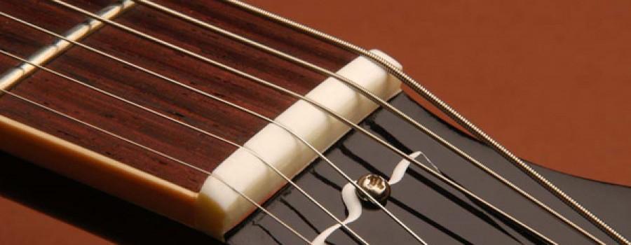 Làm gì khi dây đàn guitar bị rè